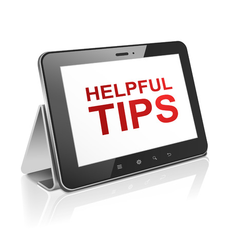 tips: tablet computer with text helpful tips on display over white