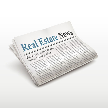 folded newspaper: real estate news words on newspaper over white background
