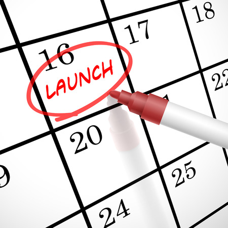 office product: launch word marked on a calendar by a red pen