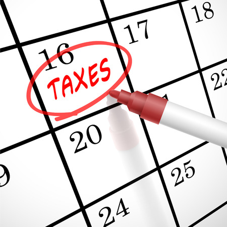 taxes word circle marked on a calendar by a red pen