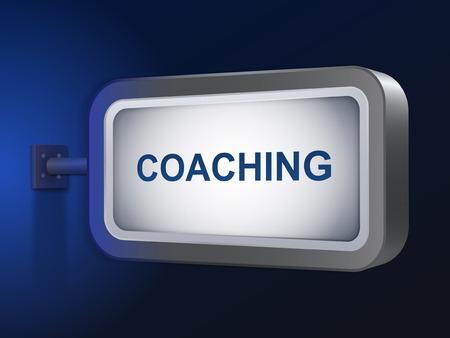 coaching: encadrement mot sur panneau sur fond bleu