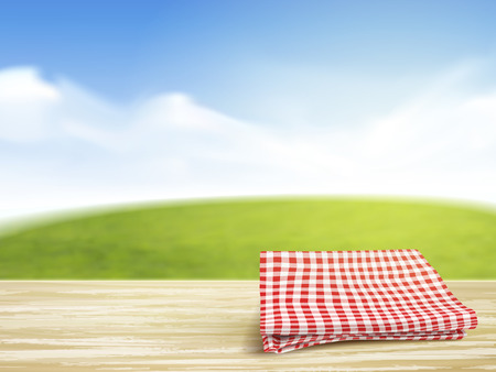 closeup look of wooden desk and tablecloth over blue sky