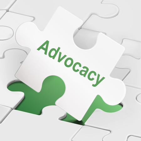 advocacy: advocacy word on white puzzle pieces background