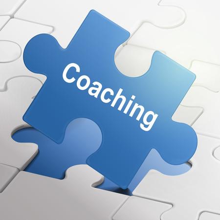 coaching: encadrement mot sur fond bleu pi�ces de puzzle fond