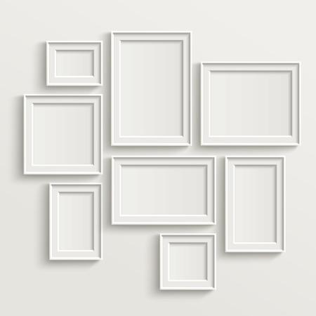 sjabloon: leeg fotolijstje sjabloon set geïsoleerd op de muur