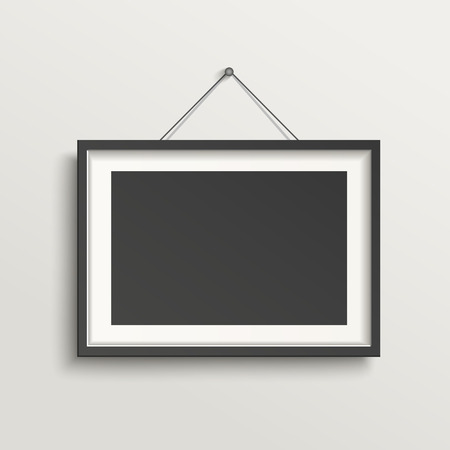 picture: blank picture frame template hanging on wall