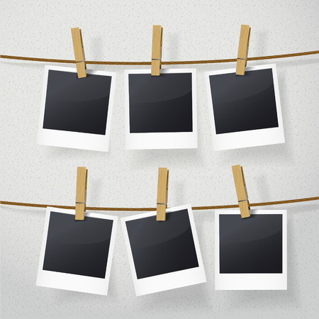 blank photo frames on rope over white background Ilustracja