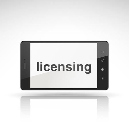 classified ads: licensing word on mobile phone isolated on white
