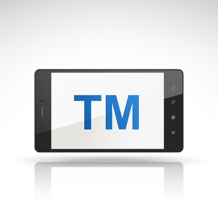 tm: TM word on mobile phone isolated on white