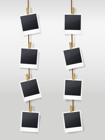 blank photo frames on clotheslines isolated on white Vector