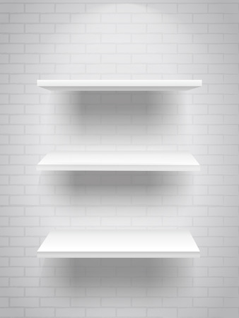 trade show: blank white shelves with illumination isolated on brick wall