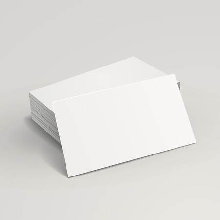 blank business cards stack up over grey background