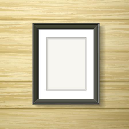 zwart kader opknoping op de houten muur