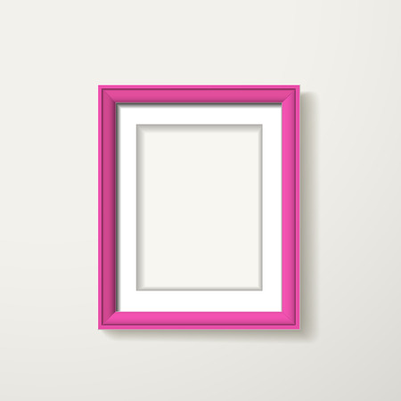 흰 벽에 걸려 핑크 프레임 워크