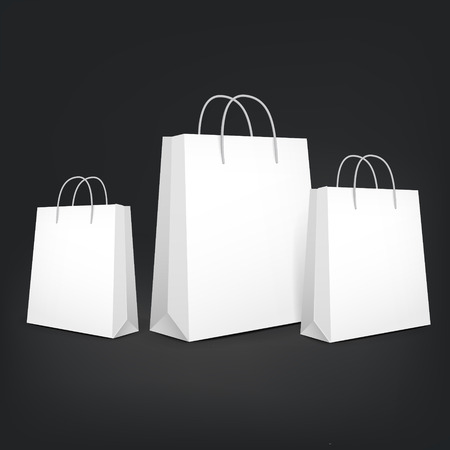 closeup on bags: 3d blank shopping bags isolated on black background