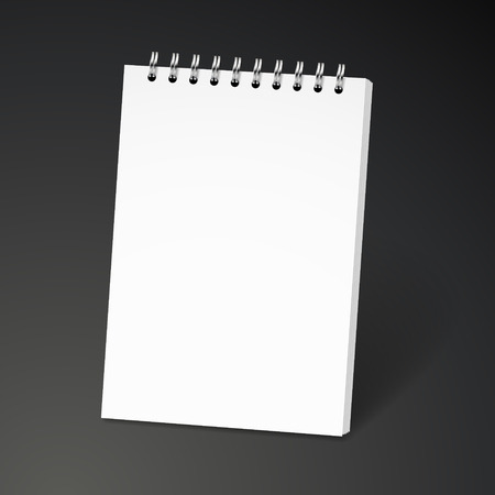 note book: blank spiral notebook isolated on black background