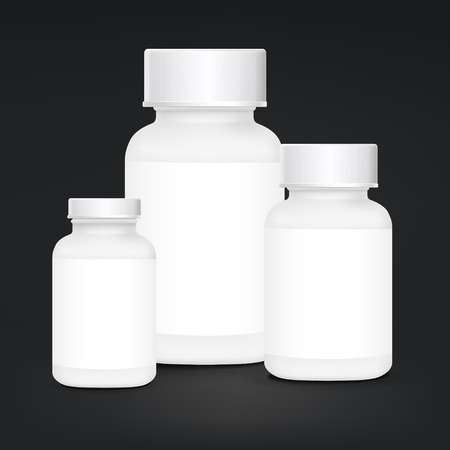 placebo: white plastic medical container set isolated on black background