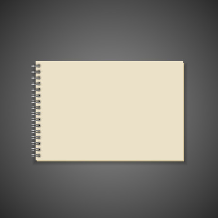 spiral notebook: blank spiral notebook isolated on black background