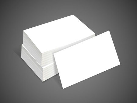 pile of papers: blank business card isolated on black background