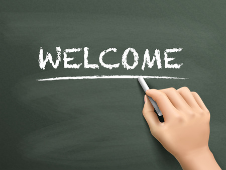 regard: welcome word written by hand on blackboard