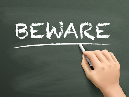 dangerously: beware word written by hand on blackboard