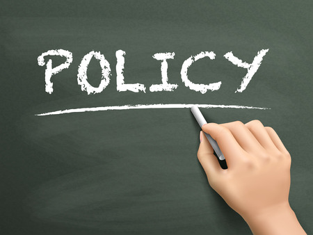 policy: policy word written by hand on blackboard