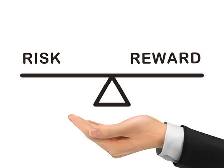 rewards: balance between risk and reward holding by realistic hand over white background