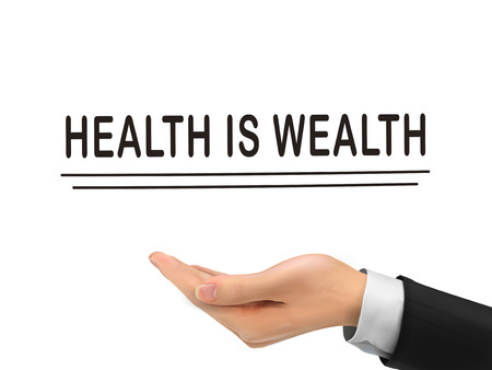 wealth abstract: health is wealth words holding by realistic hand over white background