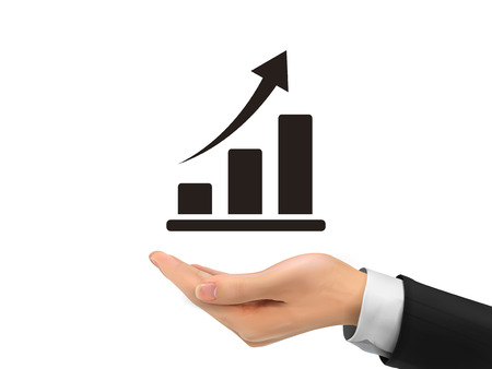 growing business: growing graph holding by realistic hand over white background