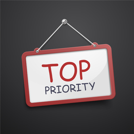 crucial: top priority hanging sign isolated on black wall
