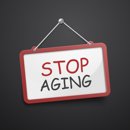 anti aging: stop aging hanging sign isolated on black wall