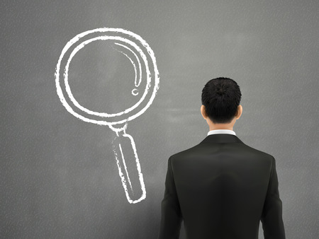 back view student: businessman with magnifying glass sketch over grey background