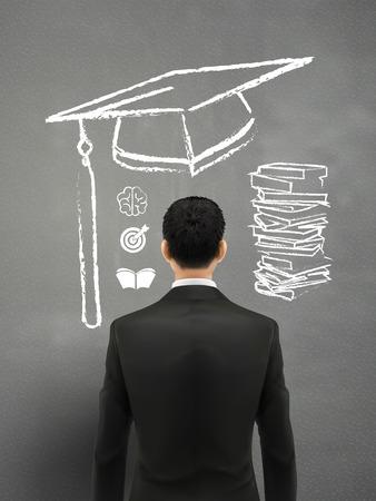 dream job: businessman with graduation cap over grey background