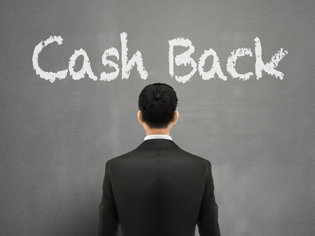 cash back: businessman with cash back words over grey background