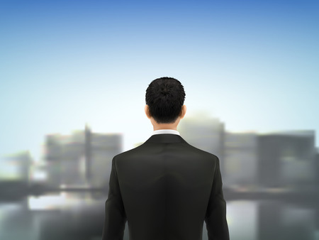 extensive: businessman looking into blurred extensive city scenery