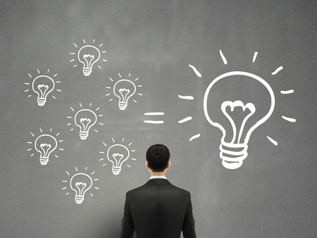 ingenuity: cooperate concept: businessman stands in front of bulbs elements Illustration