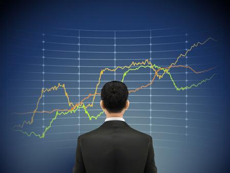 zakenman staat voor forex grafiek over blauwe achtergrond