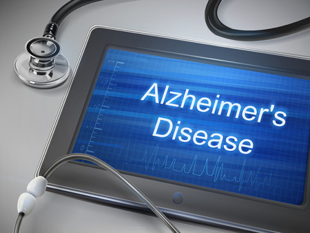brain aging: alzheimers disease words display on tablet over table