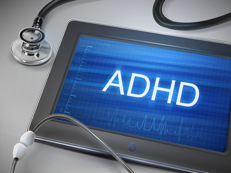 adhd: ADHD word display on tablet over table