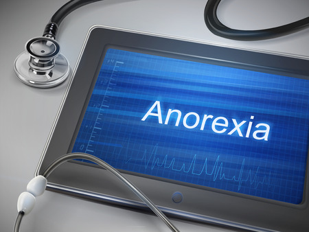 anorexia: anorexia word display on tablet over table Illustration