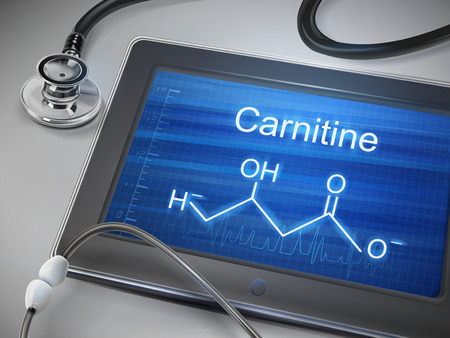 amino: carnitine word display on tablet over table