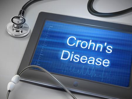 crohn 病の言葉をテーブルの上のタブレットに表示します。