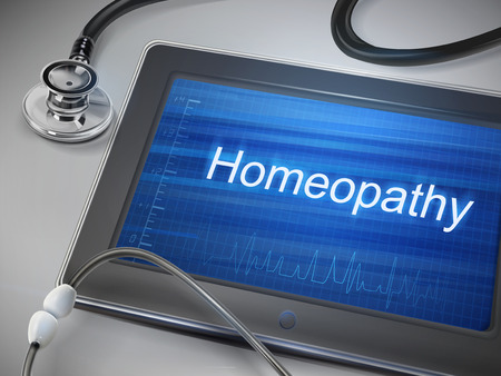 homeopathy: homeopathy word display on tablet over table