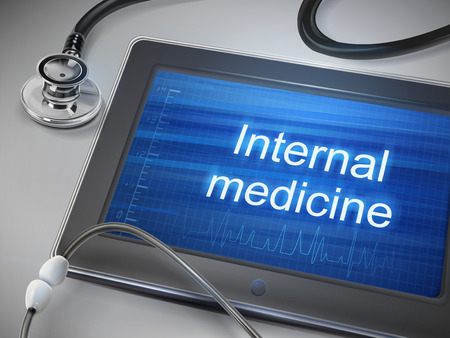 internist: internal medicine words displayed on tablet with stethoscope over table