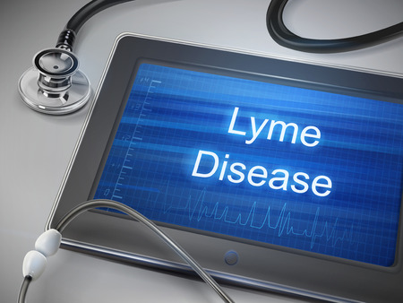 borreliosis: lyme disease words displayed on tablet with stethoscope over table