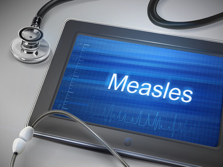 measles: measles word displayed on tablet with stethoscope over table Illustration