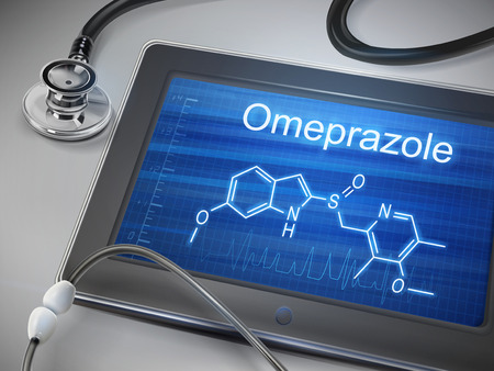 reflux: omeprazole word displayed on tablet with stethoscope over table