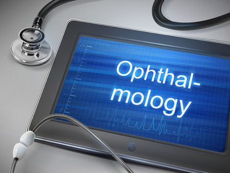 retina display: ophthalmology word displayed on tablet with stethoscope over table