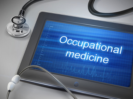 health care research: occupational medicine words displayed on tablet with stethoscope over table