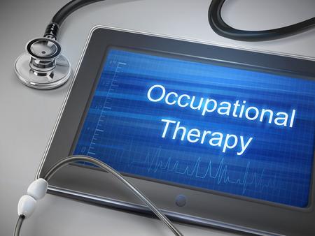 terapia ocupacional: palabras de terapia ocupacional que se muestran en la tableta con el estetoscopio sobre la mesa
